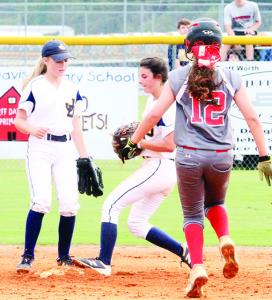 Chloe Chaney steps on second as Karli Watson looks on